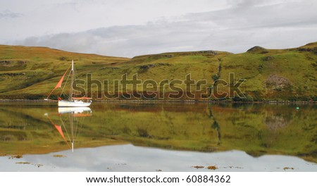 Boat on a calm Loch Harport on The Isle of Skye, Scotland - stock photo