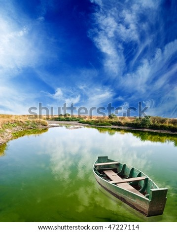 boat on a green lake