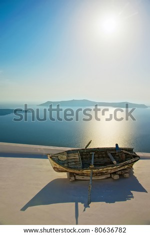 Boat on a roof at Santorini island - stock photo