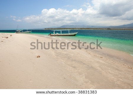 Boat on a tropical beach - stock photo