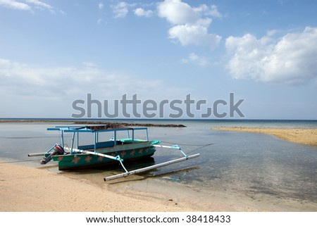 Boat on a tropical beach of the Gili Air Island in Indonesia, Asia. - stock photo