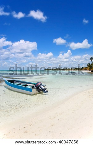 Boat on beach at Punta Cana, Dominican Republic - stock photo