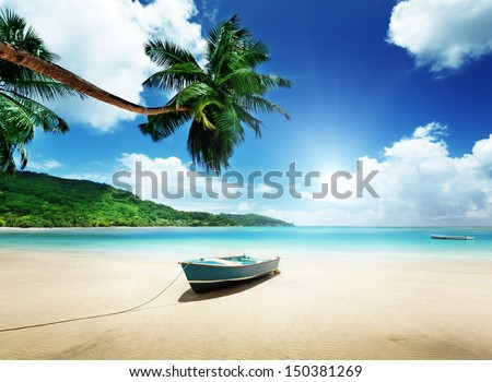 boat on beach Mahe island, Seychelles - stock photo
