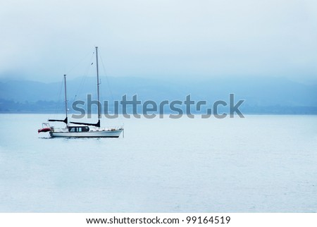 Boat on calm sea water - stock photo
