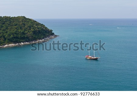 Boat on calm sea water in Phuket - stock photo