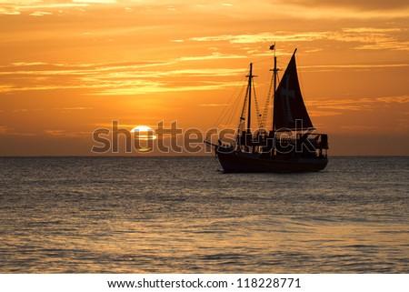 boat on horizon - stock photo