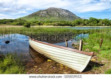 Boat on lake in Connemara National Park in Ireland. - stock photo