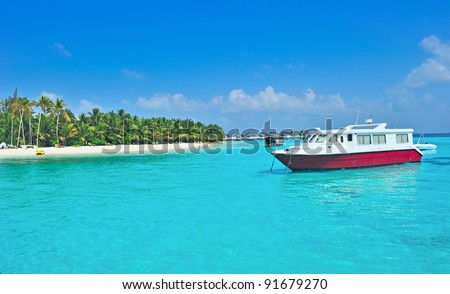 Boat on maldives sea - stock photo
