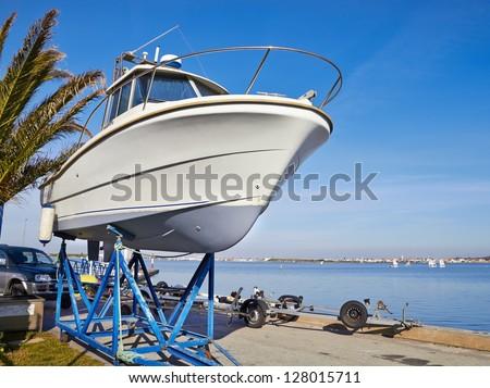 boat on repair in dry dock - stock photo
