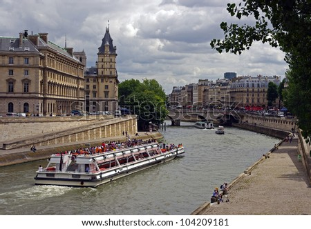 Boat on river Seine in Paris, France - stock photo
