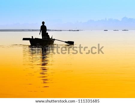 Boat on sunset. - stock photo