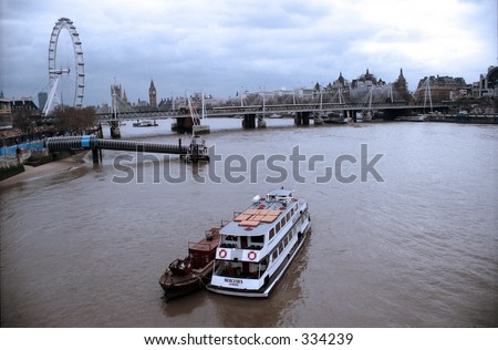 Boat on Thames River in London - stock photo