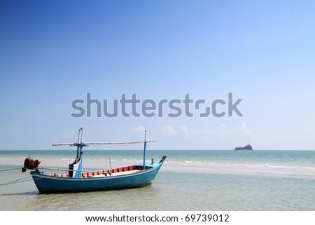 boat on the beach at hua hin,thailand - stock photo