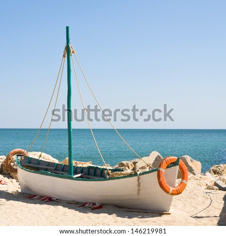 Boat on the beach at sunrise time  - stock photo