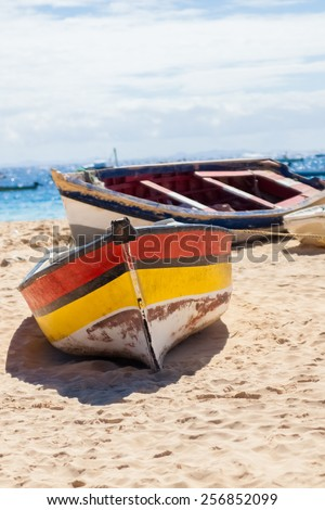 Boat on the beach at sunrise time, Sal - Cabo Verde - stock photo