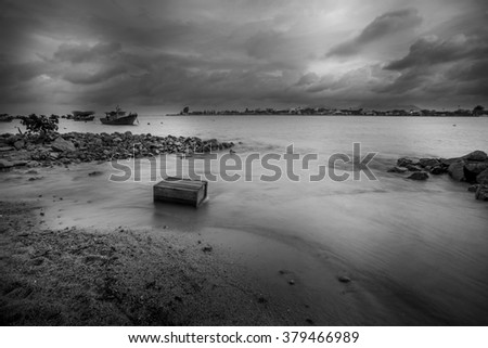 Boat on the beach in black and white - stock photo