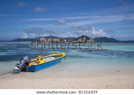 Boat on the beach in Seychelles La Digue island - stock photo
