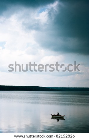 boat on the blue lake with cloudy sky, boats series - stock photo