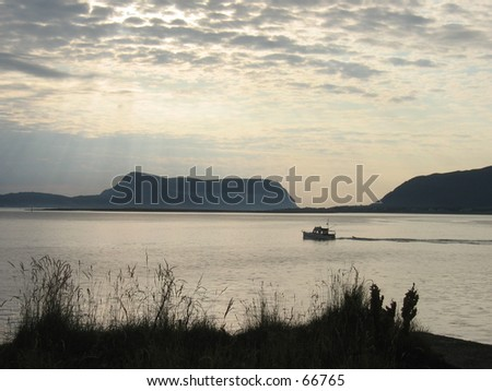 Boat on the fjord. - stock photo