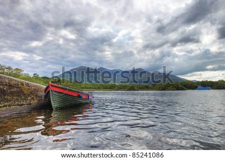 Boat on the lake in Killarney National Park in Ireland. - stock photo