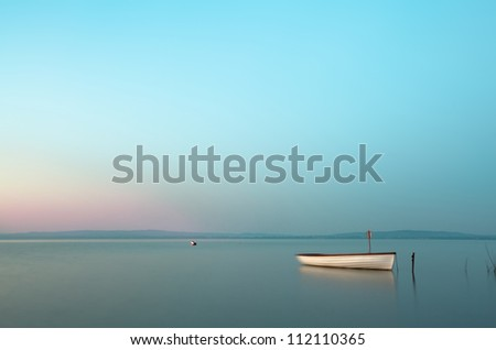 Boat on the lake,morning from Hungary - stock photo