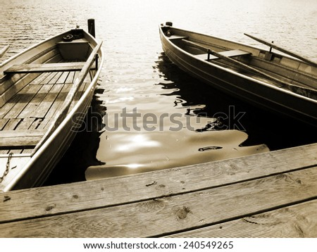 boat on the lake, sepia - stock photo