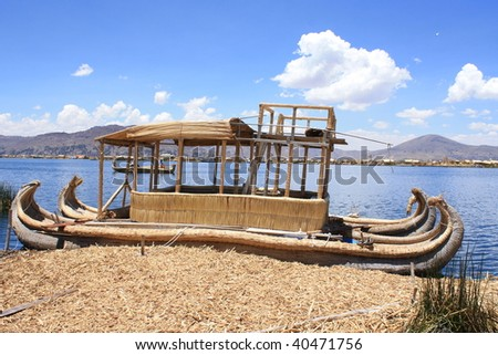 boat on the lake Titicaca - stock photo