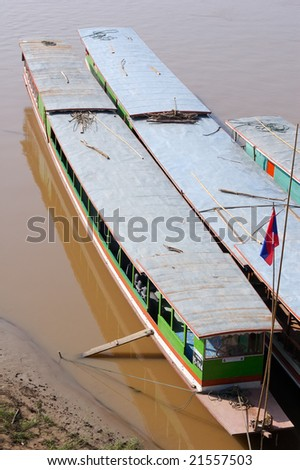 Boat on the Mekong river, Laos - stock photo
