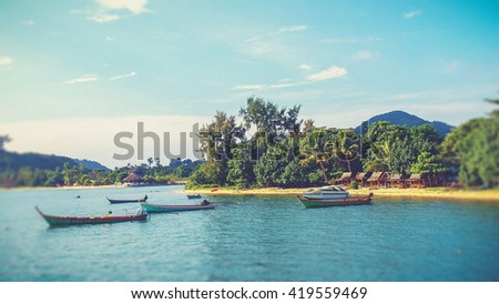 boat on the sea at payam island, Thailand (filter effect used) - stock photo