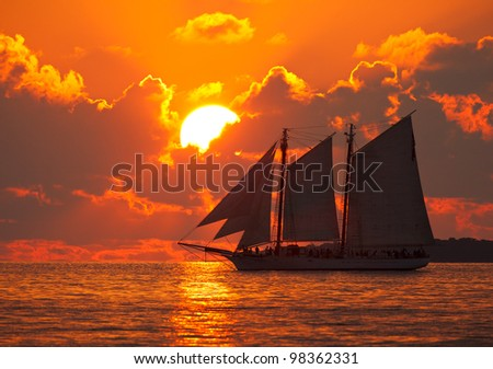 Boat on the sea at sunset in Key West, Florida.