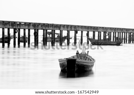 boat on the sea in black and white