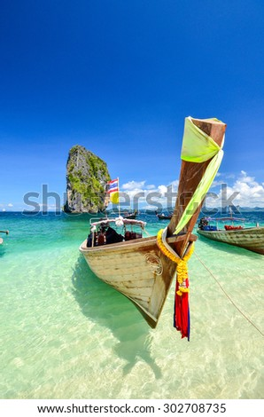boat on the sea in Po-Da Island ,Krabi , Thailand .And the clear sky - stock photo