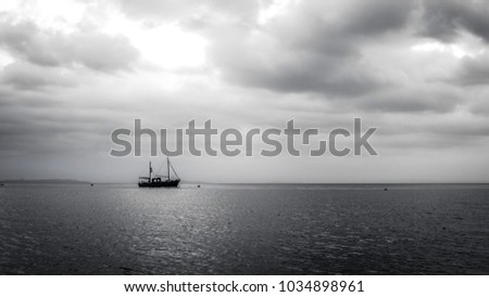 Boat on the water. Dramatic sky over a boat. Clouds over a boat.