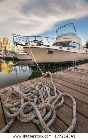 Boat on the waterfront marina in downtown Toronto  - stock photo