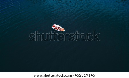 boat on water with red vivid color - stock photo