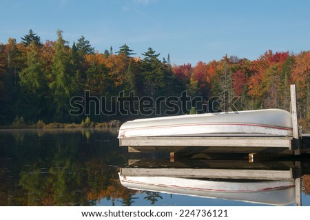 Boat overturned on the dock done with the summer season - stock photo