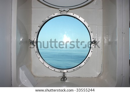 Boat Porthole with ocean view - stock photo