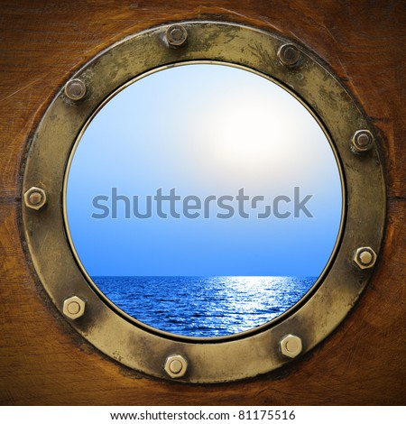 Boat porthole with ocean view close up - stock photo