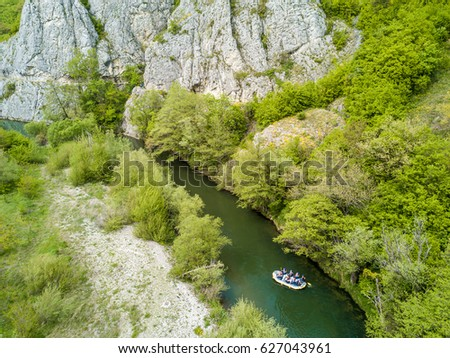 Boat rafting on river. Aerial view from a drone