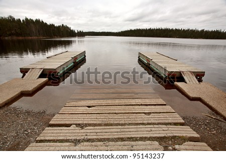 Boat ramp and docks on Northern Manitoba lake - stock photo