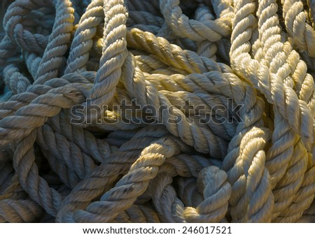 boat rope twisted on the deck - stock photo