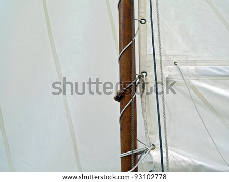 Boat sail and mast; good copy space over white sail - stock photo