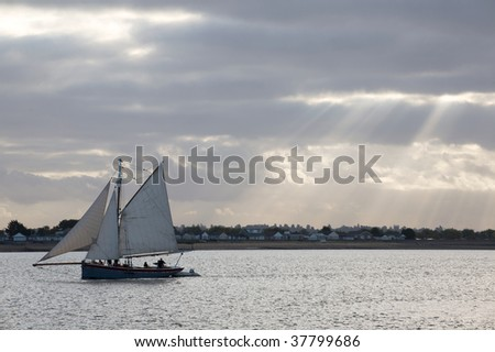 Boat sailing in front of stunning clouds