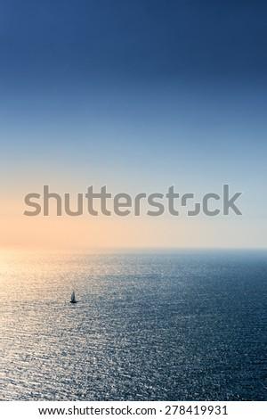 Boat sailing in the blue Aegean sea - stock photo