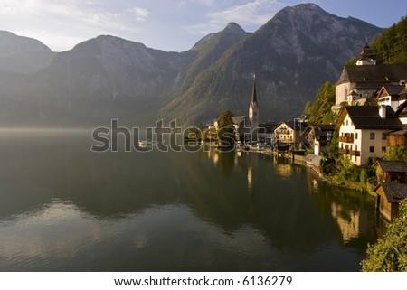 Boat sailing into the morning fog Hallstatt, Austria - stock photo