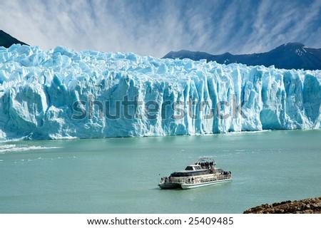 Boat sailing near Perito Moreno glacier, in Patagonia, Argentina. - stock photo