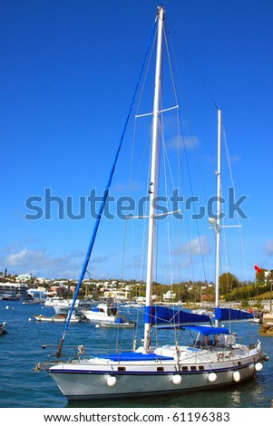 Boat setting sail in the harbor - stock photo
