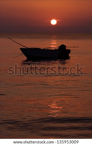 boat sunset red and relax near the jamaica caribbean beach - stock photo