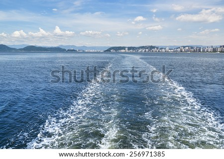 Boat trail in the sea with views of the island city of Santos in Sao Paulo - stock photo