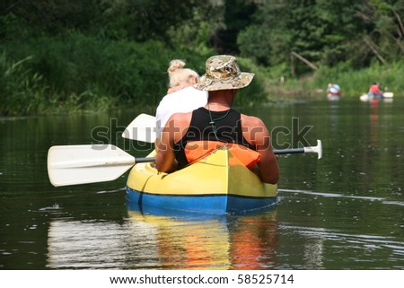 boat trip: young couple kayaking on the river - stock photo